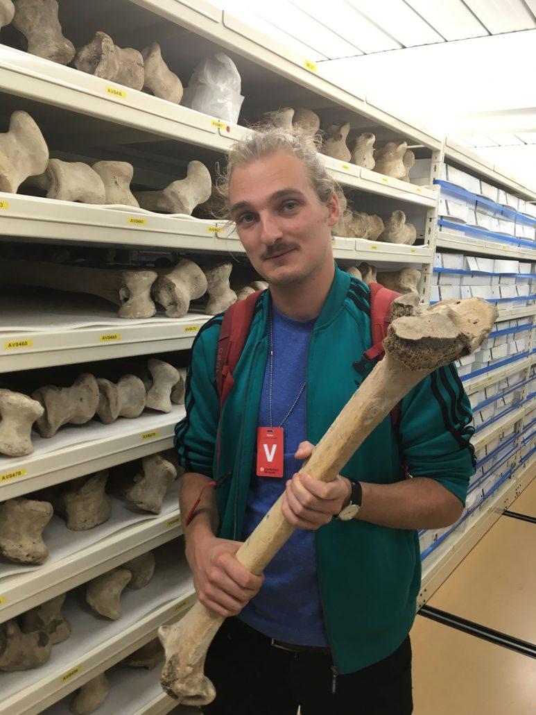 Scholar Frederik Seershol holding up a large bone